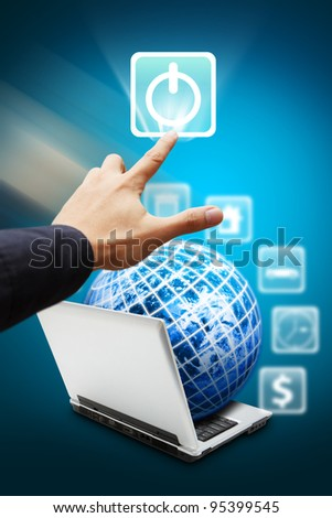 Smart hand press on Power icon from Notebook computer : Elements of this image furnished by NASA - stock photo
