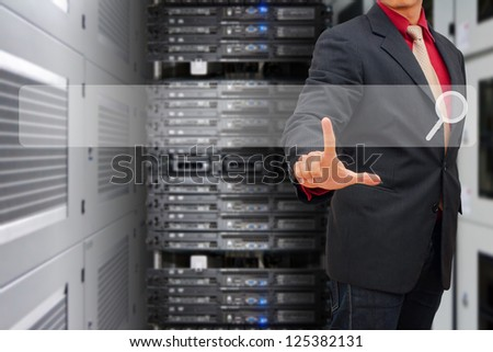 Smart hand press on Search bar in data center room - stock photo