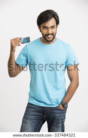 Smart happy beard Indian young man with credit card on white. - stock photo