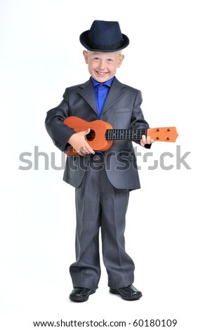 Smart Happy Boy in a Suit playing Guitar - stock photo