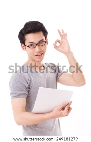 smart, happy, smiling hipster nerd or geek man with glasses showing ok hand sign gesture - stock photo