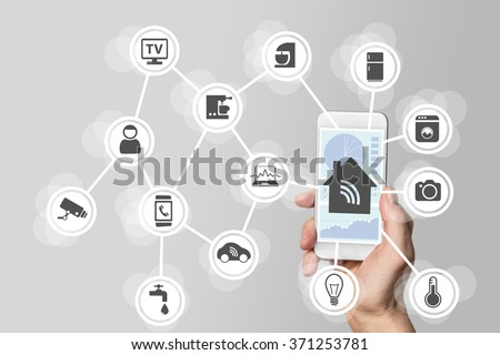 Smart home automation concept illustrated by modern smartphone to monitor appliances. - stock photo