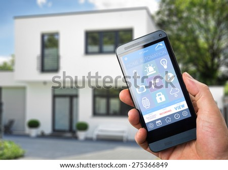 smart house, home automation, device with app icons. Man uses his smart phone with smarthome security app to unlock the door of his house.