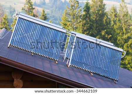 Smart House.Solar water heaters on the roof of private home