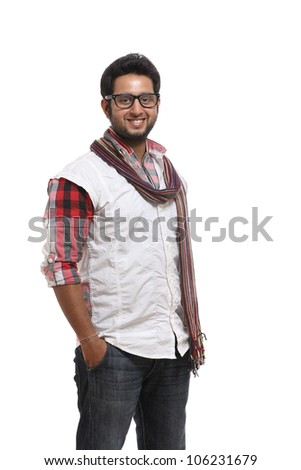 Smart Indian young man posing on white background.