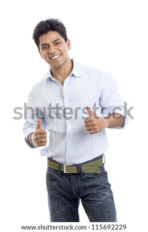 Smart Indian young man showing success sign on white. - stock photo