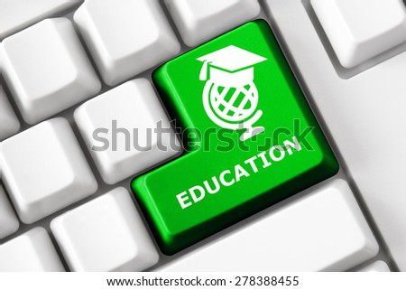 Smart keyboard with education images and text - stock photo