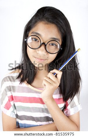 smart kid, Asian female kid with glasses hold pencil. - stock photo