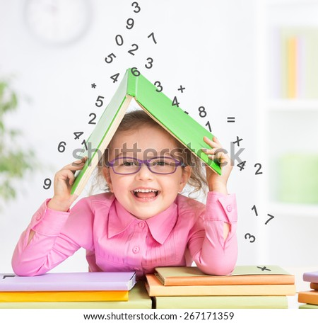 Smart kid in glasses under falling digits - stock photo