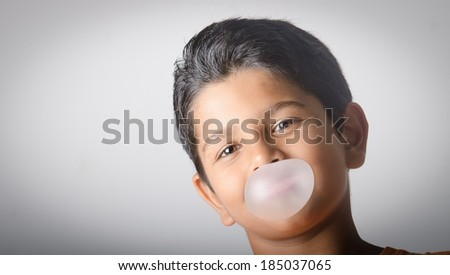Smart kid with bubble gum - stock photo