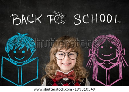 Smart kids in class. Happy children against blackboard. Education concept - stock photo