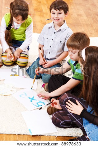 Smart kids writing numbers and counting - stock photo