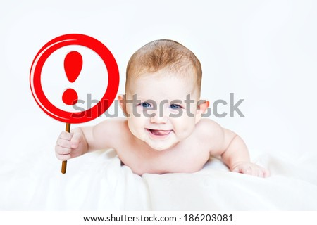 "Smart little boy holding a sign ""NO"" in the hands. In light background. - stock photo"