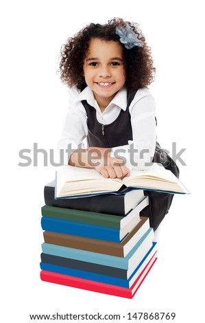Smart little bright kid preparing for exams - stock photo