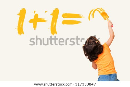Smart little girl writing the right answer for math equation with painting brush on wall background - stock photo