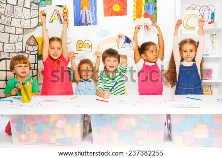 Smart little kids learning letters and writing - stock photo