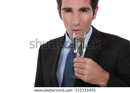 Smart man drinking champagne - stock photo