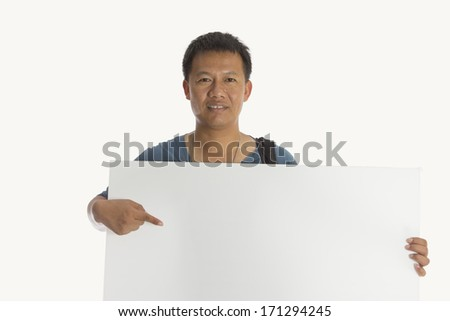 Smart man holding a white board.