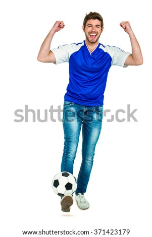 Smart man holding football with arms raised on white screen - stock photo