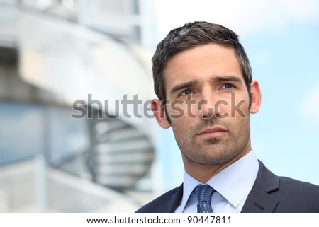 Smart man looking away outdoors - stock photo