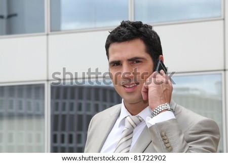 Smart man talking on phone - stock photo