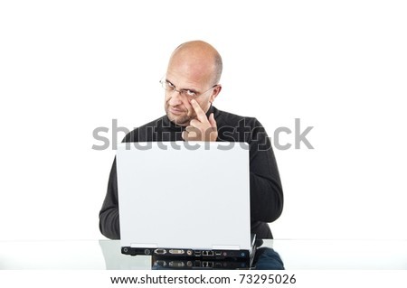 Smart man with computer looking into the camera - stock photo