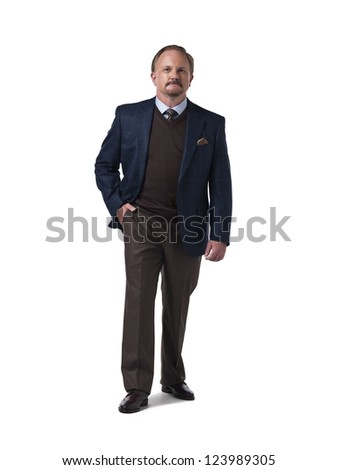 Smart mature businessman with hands in pocket against white background