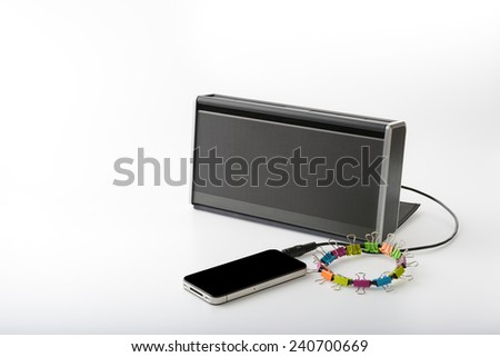 smart mobile phone connect with portable speaker for playing music on white background - stock photo