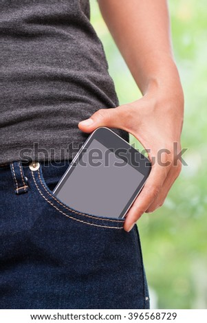 Smart mobile phone in jeans pocket with blank screen.