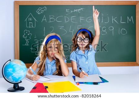smart nerd student in classroom raising hand with sad friend - stock photo