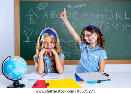 smart nerd student in classroom raising hand with sad friend - stock photo