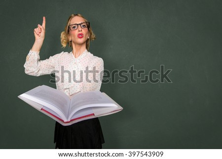 Smart nerd teacher substitute lecturing class with text book in classroom space for print - stock photo