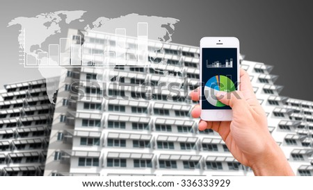 Smart phone and building background  - stock photo