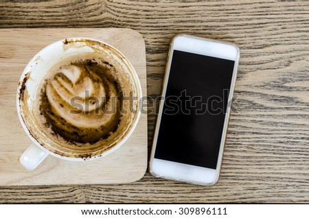 Smart phone and coffee cup - stock photo