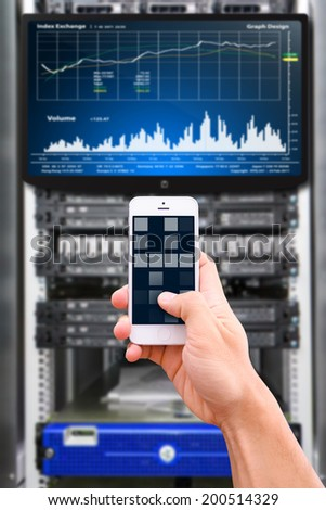 Smart phone and graph monitor system  - stock photo