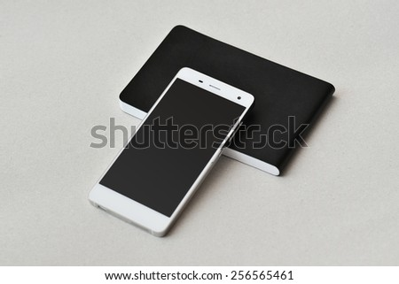 Smart phone and notebook, isolated - stock photo