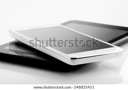 Smart Phone And Tablet Isolated On White - stock photo
