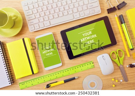 Smart phone and tablet mock up template on office desk. Can be used for app presentation and promotion - stock photo
