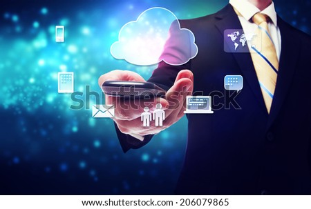 Smart phone cloud connectivity service theme with businessman - stock photo
