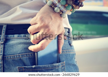 Smart phone in jeans pocket - stock photo