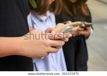 Smart phone messaging:close up people using cellular mobile device for working/relax concept:shallow focus on hand of man and woman play smartphone for make appointment/read news/social media network - stock photo