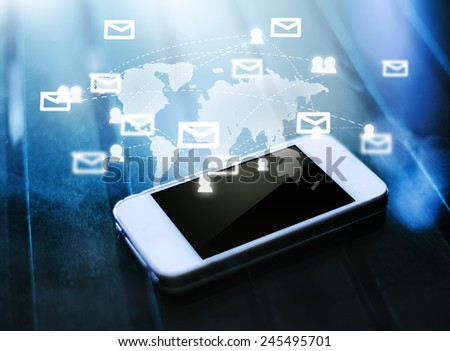 Smart phone on table show the social network,technology concept  - stock photo
