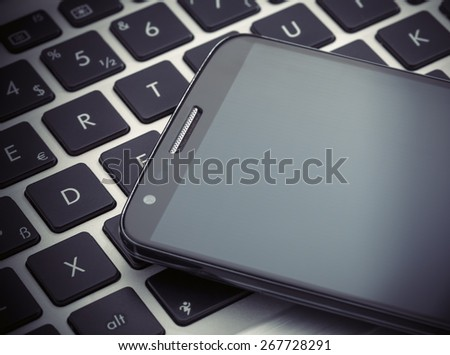 smart phone on tablet computer. technology and communication concept. - stock photo
