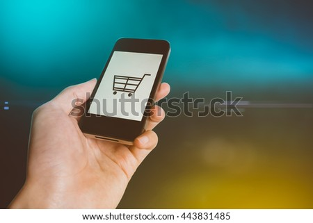 Smart phone online shopping in Human hand - mobile business and modern lifestyle concept - stock photo