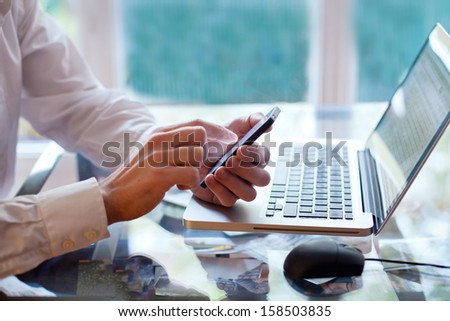smart phone or computer - stock photo