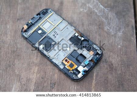 smart phone repair on wood table - stock photo