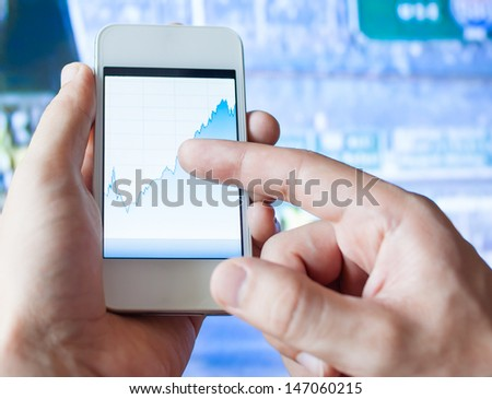 Smart phone stock chart - stock photo