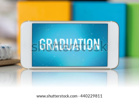 Smart phone which displaying Graduation - stock photo