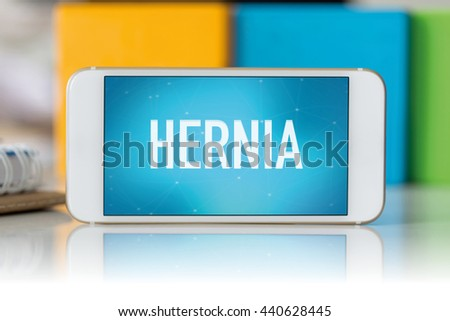 Smart phone which displaying Hernia - stock photo