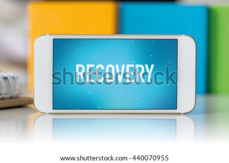 Smart phone which displaying Recovery - stock photo